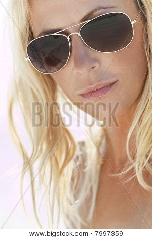 Backlit Photograph Of Sexy Blond Girl In Aviator Sunglasses