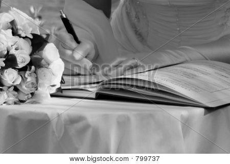 Bride signing registrar