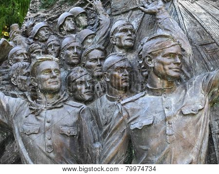 Bas-relief, Depicting Faces Of Triumphant Soldiers