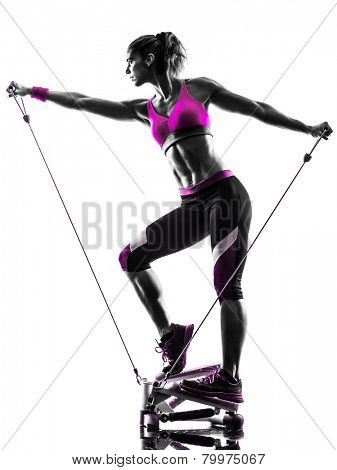 one caucasian woman exercising stepper resistance bands fitness in studio silhouette isolated on white background