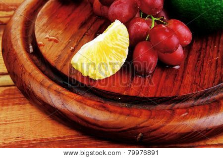 fresh raw red grape on wooden table