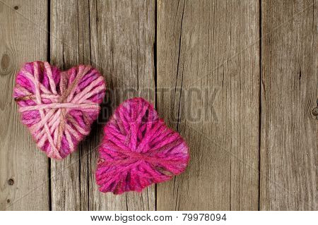 Wool hearts on wood