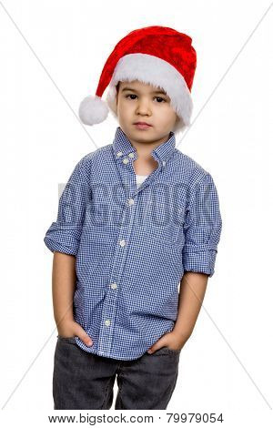 little boy with santa hat, symbol of christmas, self-confidence, transparency