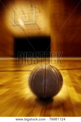 Basketball on wooden floor of old basketball court