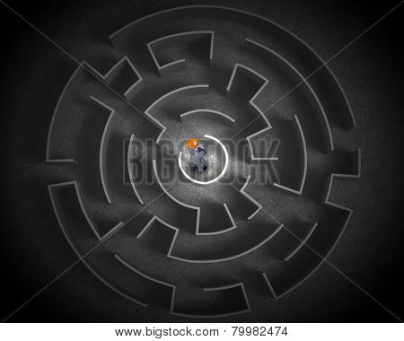 Puzzled businessman standing in center of labyrinth