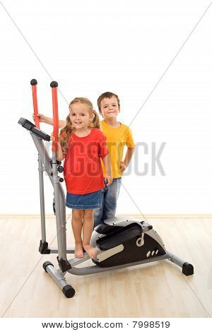 Two Kids On A Fittness Equipment