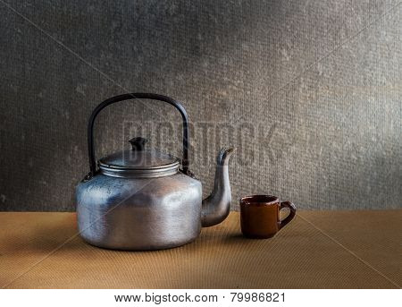 Vintage Still Life With Kettle On Wooden Backgro