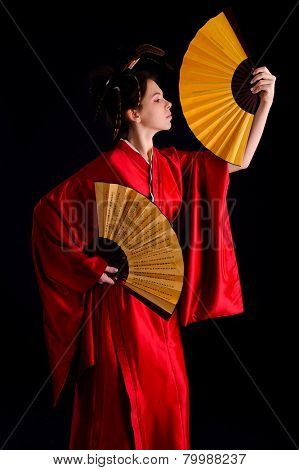 The girl in native costume of japanese geisha, isolated on black