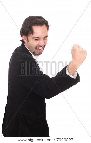 Laughing Business Man With Hand Clenched To Fist
