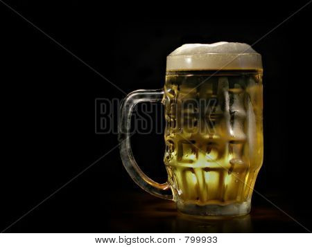 Beer mug against black background