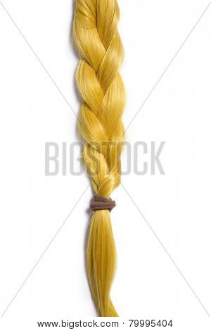 Golden blond hair braided in pigtail, isolated on white background