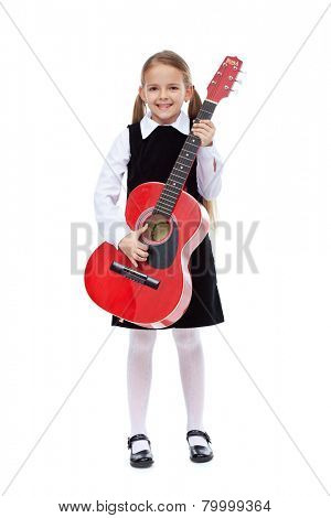 Happy girl with elegant outfit and guitar - standing, isolated