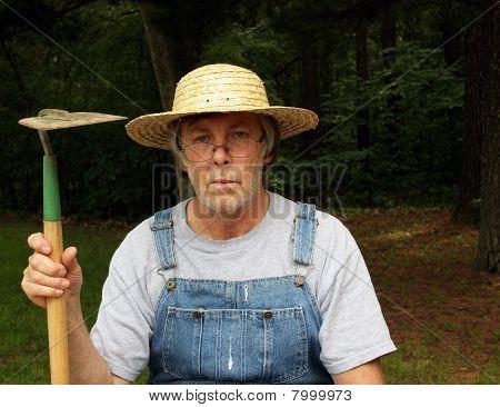 Farmer Portrait Holding Hoe