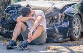 picture of ambulance car  - man injured after car crash wait for ambulance - JPG
