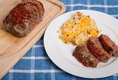 image of hash  - A Meatloaf dinner with hash brown potatoes - JPG