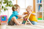 foto of home addition  - kids boys play with counter toy indoor in nursery or at home - JPG