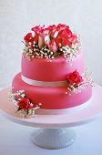 picture of cake stand  - Gorgeous wedding cake decorated with pink fondant and fresh roses  - JPG