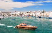 Trani touristic port with luxury yacht. Apulia. poster