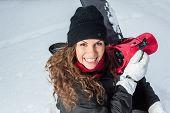 image of snowboarding  - Happy Young Female Snowboarder outdoors - JPG