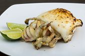 pic of cuttlefish  - Grilled cuttlefish with lime on the wooden background - JPG