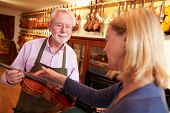 foto of leaving  - Customer Leaving Violin For Repair In Shop - JPG
