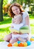 stock photo of mother baby nature  - Beautiful Mother And Baby reading outdoors - JPG