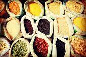 stock photo of legume  - Diverse Multi Colored Legume Bean Sack Market - JPG