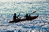 stock photo of kayak  - Father and son kayaking silhouette at sea - JPG
