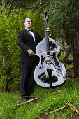 image of double-bass  - man in tuxedo playing the double bass in park - JPG