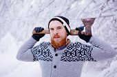pic of ax  - Lumberjack in the snowy winter forest - JPG