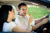 image of feeding  - Couple in car  - JPG