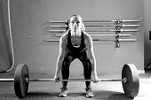 stock photo of lifting weight  - female athlete is preparing to lift deadlift at the box  - JPG