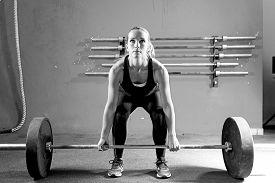 pic of jerks  - female athlete is preparing to lift deadlift at the box  - JPG