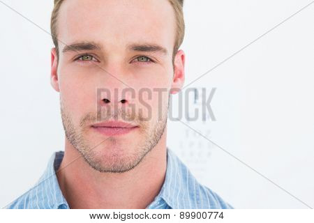 Unsmiling handsome looking at camera on white background