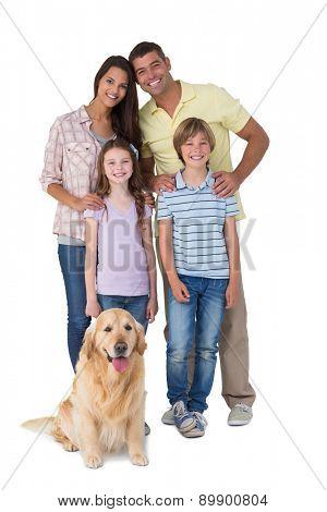 Portrait of happy family standing with dog over white background