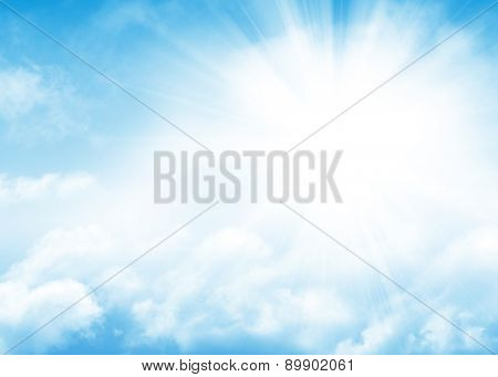 Blue sky, sun and clouds abstract background with copy space