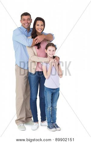 Portrait of happy family embracing each other over white background