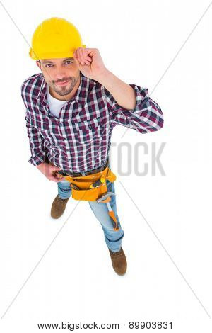 Smiling handyman looking at camera on white background