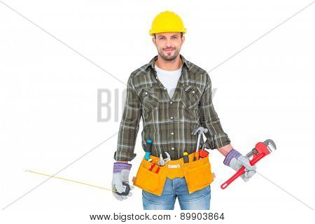 Manual worker holding various tools over white background
