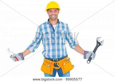 Portrait of handyman holding hand tools on white background