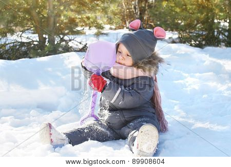 Little Child Playing On The Snow In Winter Day