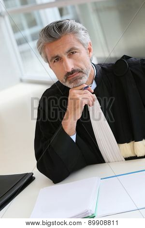 Mature lawyer working on judgement report