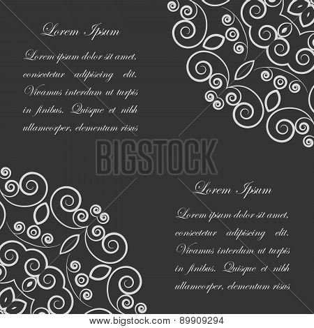 Black background with white ornate pattern