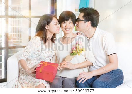 Happy mothers day. Asian boy and girl kissing mother. Family living lifestyle at home.
