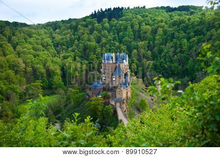 Eltz castle view from above among forest hills