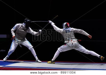 ST. PETERSBURG, RUSSIA - MAY 2, 2015: Dmitry Rigin of Russia vs Andrea Cassara of Italy in the final of International fencing tournament St. Petersburg Foil. The tournament is the stage of World Cup
