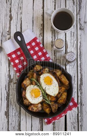 eggs and potatoes on a breakfast table