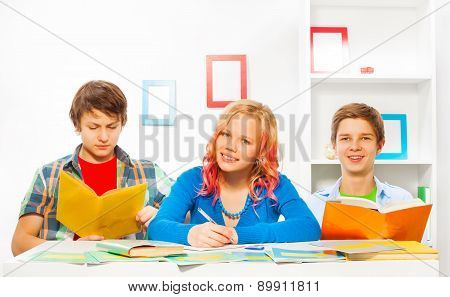 Boys and girl do homework together at home