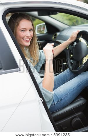 Young woman in the drivers seat in her car