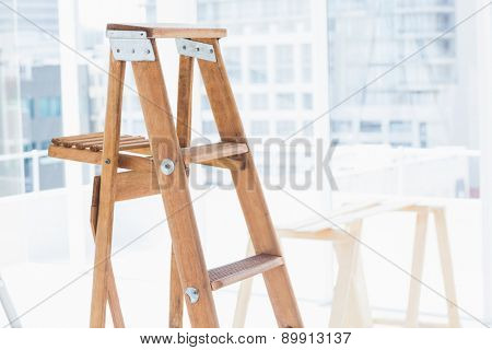 Wooden step ladder in bright office